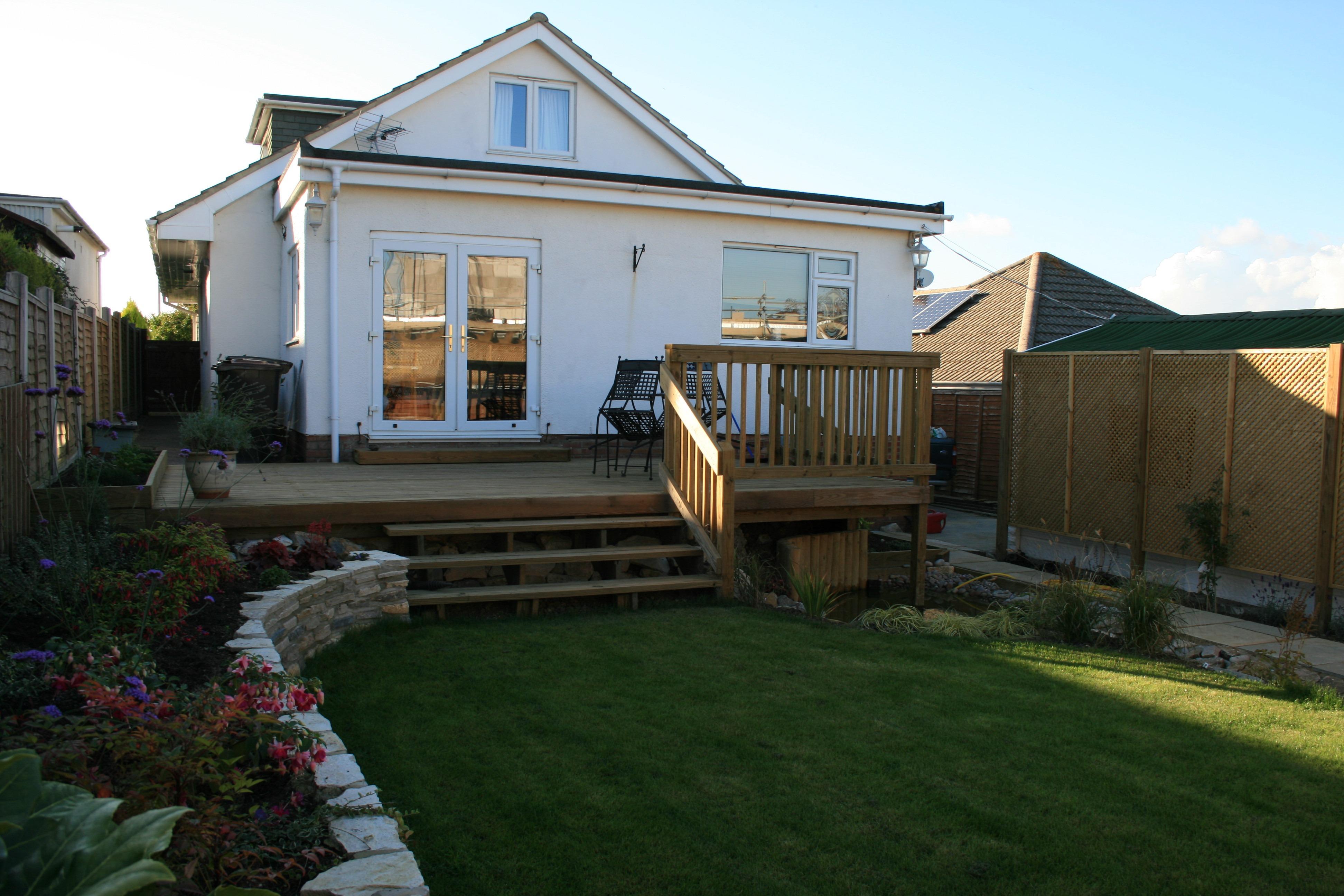 Decking on stilts 1 killen landscapes garden design for Garden design bournemouth