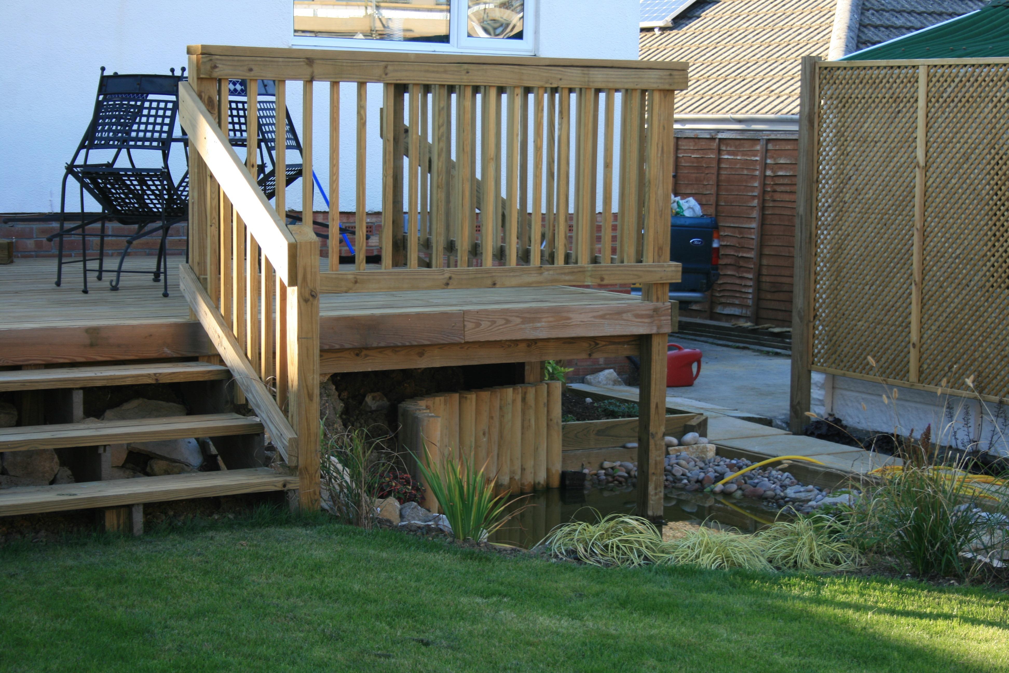 Decking on stilts killen landscapes garden design for Garden design bournemouth